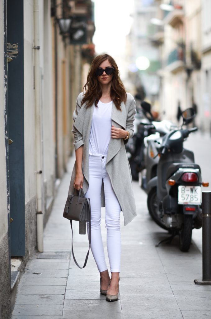 Barbora Ondrackova pairs white jeans with an effortlessly chic grey coat, creating a sophisticated aesthetic which is perfect for any occasion! Wear a style such as this with minimal accessories so as not to take away from it's stripped back, cool look.   Top: Topshop, Trousers: Mango, Coat: Zara, Heels: Buffalo, Bag: Saint Laurent.