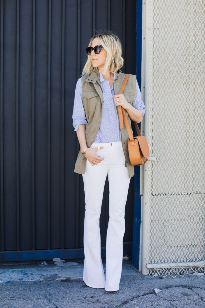 Why not try giving white flares a go? In a pair of wide leg white jeans and a plain pastel blue button up, Jacey Duprie looks stylish and alternative, attracting attention to her silhouette! We love this look for a sophisticated every day style.   Jeans: Frame Denim.