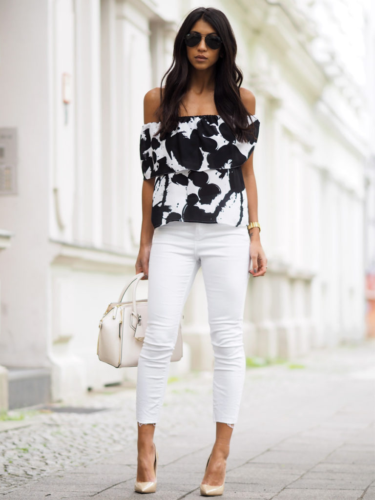 White jeans can also make a perfect match to a more formal top, like this striking monochrome off the shoulder piece worn by Kayla Seah. An elegant outfit like this is perfect for more formal parties and occasions!  Shirt/Bag: Rebecca Minkoff, Jeans: Rag & Bone, Heels: Jimmy Choo.