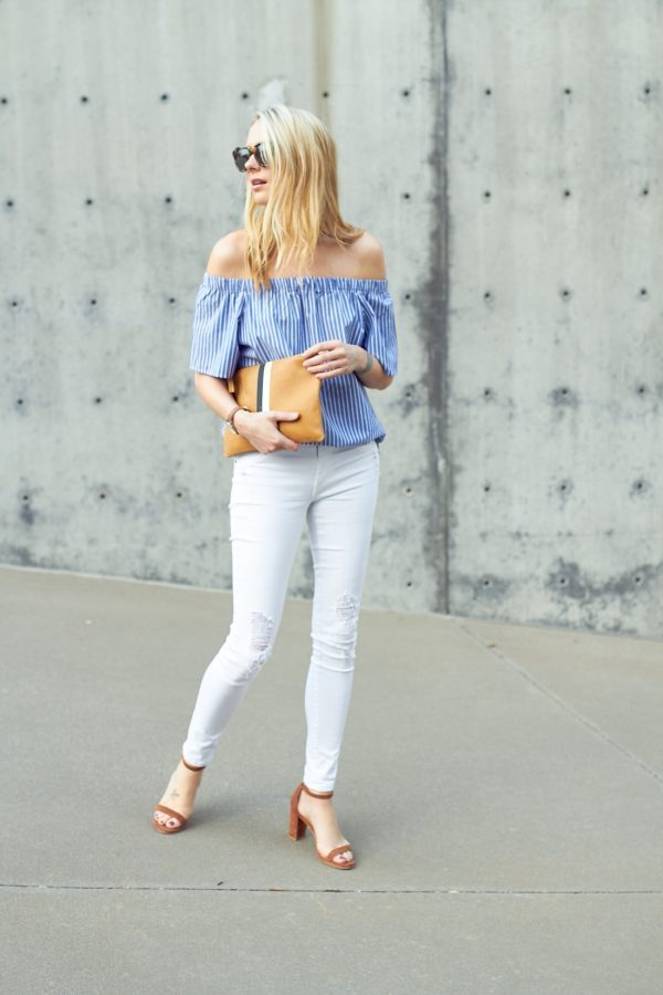 White jeans are the perfect match to a statement printed top like this cute blue & white striped blouse from Banana Republic. Amy Jackson wears these two pieces with a pair of neutral coloured heels to achieve a simple but stylish summer look! Top: Banana Republic, Jeans: James Jeans, Shoes: Stuart Weitzman, Clutch: Clare.