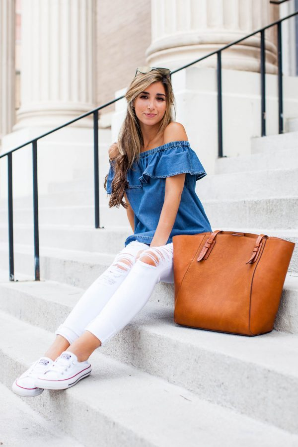 Jessi Afshin has created a super cute summer look by pairing distressed white jeans with an off the shoulder denim top and fresh white classic converse. Try this look yourself for an achievable casual look! Outfit: Nordstrom.
