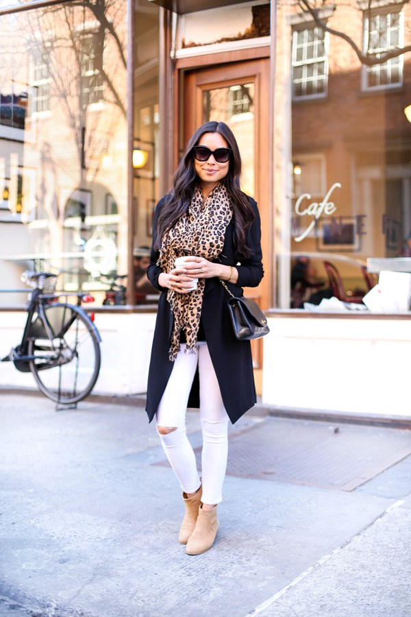 Add some glam to your everyday white jeans look by matching a statement print item like this scarf, worn by Kat Tanita, with a simple black jacket and otherwise neutral accessories. We love this stylish and original look!  Jacket: Forever 21, Tank: Alexander Wang, Scarf: Sole Society, Jeans: Frame Denim.
