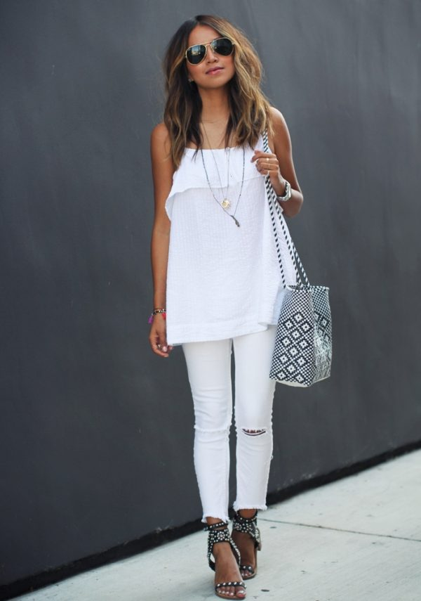 Enhance your everyday denim look by switching your usual blue for a pair of white jeans. An all white look such as this by Julie Sarinana can be used to create a pretty and feminine style, though you can also add some edge to the look through studded heels and shades! Brands not specified.