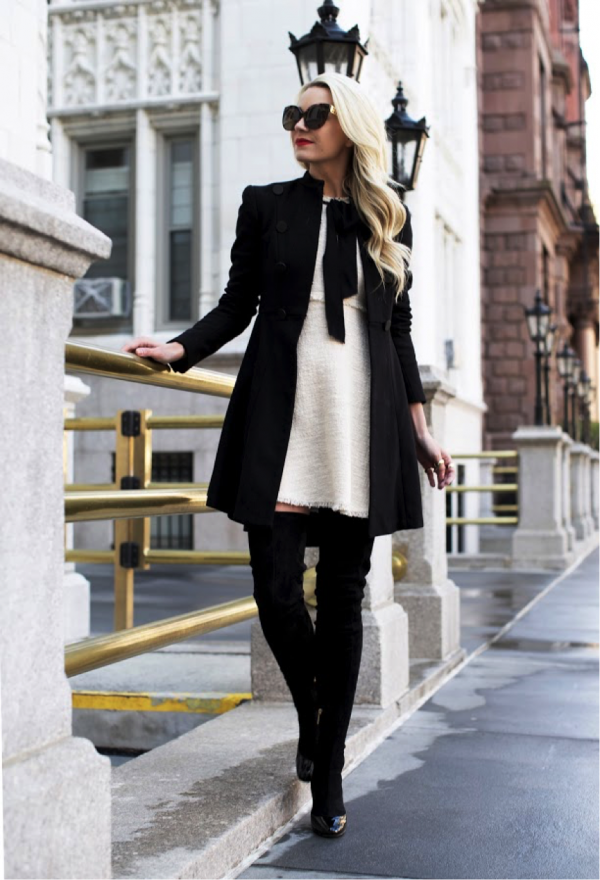 Blair Eadie is magnificent in this monochrome outfit. This chic look is given an edgy twist with the frayed edges of the dress, and the over-the-knee boots. We love this look! Dress: Zara, Coat: Alice and Olivia, Boots: Dolce & Gabbana