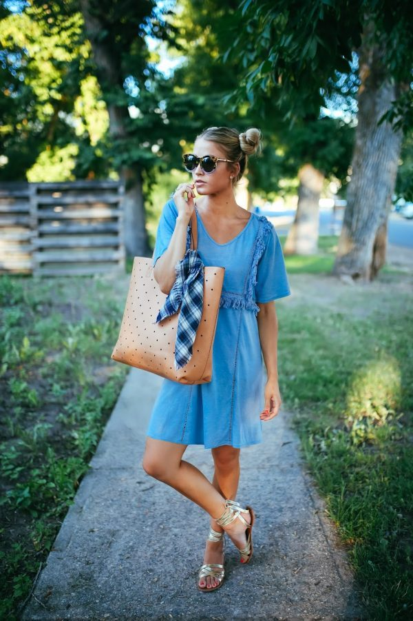 Cara Loren is utterly entrancing in this gorgeous blue dress, complete with frayed detailing for an understated but glam style! Wear this look with sandals and sunnies to steal Cara's look. Outfit: Sole Society.