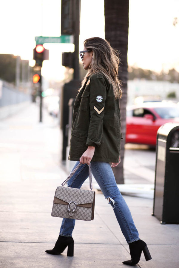 Sew patches onto your military style jacket to get this classic edgy look rocked by Jill Wallace. This look is perfect with simple jeans and a pair of heeled boots, but can also be worn with sneakers for a totally casual style. Jeans: Revolve.