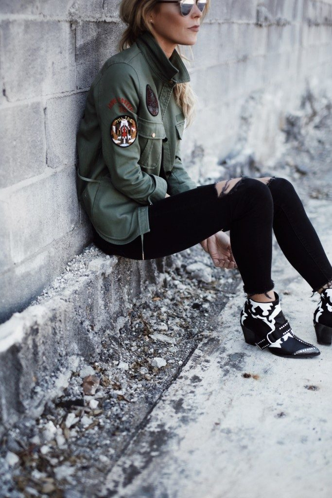 Mary Seng has personalised this khaki military jacket with multiple patches, using them to express a more original style. Wear a piece like this with a plain tee and jeans to keep attention where it should be.   Shirt/Bag/Boots: Zadig & Voltaire, Jeans: Mother.