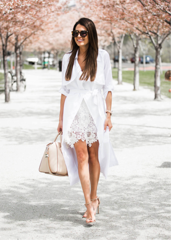 Christine Andrew is looking ultra-chic in this beautiful white trench. Paired with some statement sunglasses and a cute handbag, this is the ultimate summer look! Trench/Body Suit – Ily Couture Scallop Skirt- intermixonline Heels- Nordstrom