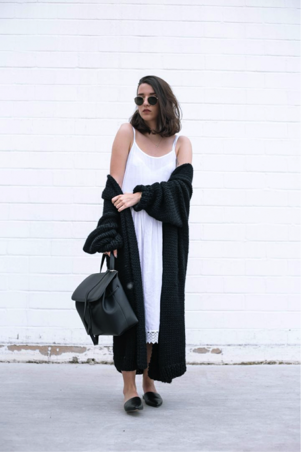 Sophie van Daniels is rocking the monochrome look- perfect for a cool summer evening, this long black knit coat and white dress really give off an edgy vibe. Styled with some oversized shades and a back pack, this outfit really would be the envy of any onlooker! Knit: Dunia Algeri, Dress: Boohoo, Bag: Eleven