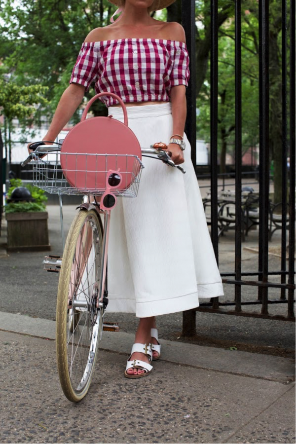 Blair Eadie is channelling chilled vintage vibes in this cute summer outfit. The gingham pattern creates a bold contrast to the sophisticated white skirt; the perfect seasonal look. Skirt/Top: Nordstrom, Sandals: Topshop