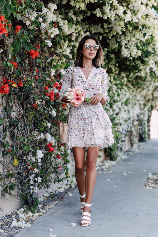 Annabelle Fleur looks fabulous in this floral number; the dainty multi-coloured flowers are super-feminine and make for an elegant summer look. Paired with some bold sunglasses and simple heels, this is the ultimate seasonal outfit. Skirt: Shopbop, Top: Nordstrom, Sandals: Marc Fisher