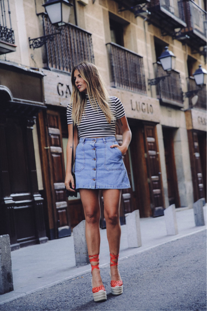 Natalia Cabezas really channels summer vibes in this outfit. The striped top and buttoned skirt are great staples this season. We love the pop of colour in these orange platform espadrilles- they are a brilliant way to brighten up any look.  Top/Skirt: Zara, Sandals: Paloma Barceló