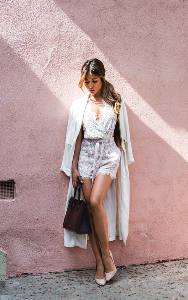 Jessi Malay looks striking in this summer lace number. The perfect colour to keep cool in the sun, the white detailing of the bodysuit is also really dainty and feminine. Paired with white heels and a white trench, a more sophisticated look is made. Bodysuit/Trench Coat/High Heels: Revolve