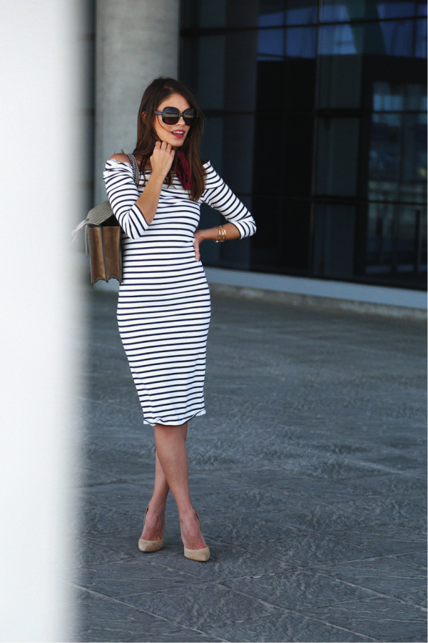 Jessie Chanes looks sophisticated in stripes. We love the simplicity of this midi-dress, especially when paired with the nude heels and neck-tie, which adds a more retro feel. Perfect for a summer day. Dress: Buleyvard, Heels: Mas34, Scarf- Vintage.
