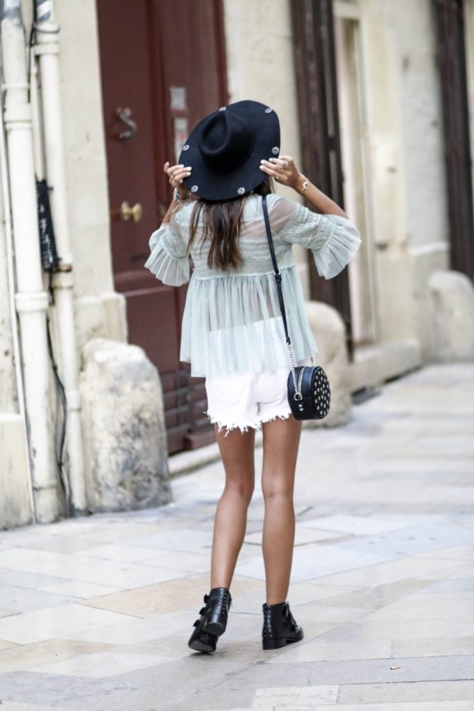 Federica L. has created an edgy and alternative style by pairing white cut off shorts with chunky black boots and a studded bag, however she has also retained some femininity by choosing a sheer flowing top to match. This look has got everything!  Top: Zara, Shorts: Boohoo, Shoes: Asos.
