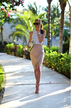 Barbora Ondrackova exudes glamour in this skirt and top combo. The small slit at the front of the skirt adds an interesting element to the look, making it a fun summer skirt. Pop on a pair of statement sunglasses to complete the look.  Top: Topshop, Skirt: River Island, Sunglasses: Celine