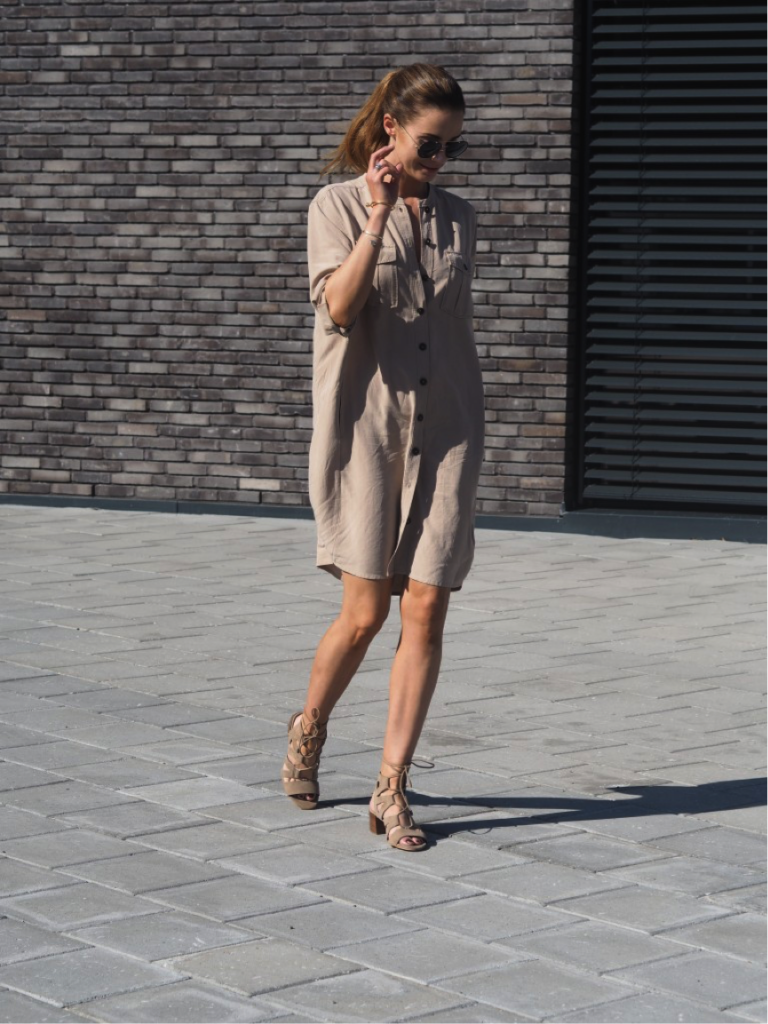 Benedicthe exudes sophistication in this beautiful beige number. The lightweight material makes for the perfect summer dress- we especially love the button detailing at the front.  Dress/Shoes: Zalando