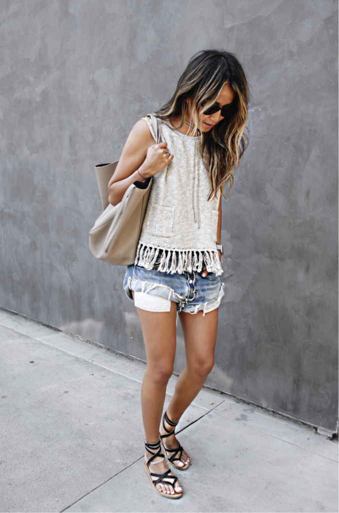 We love the detailing on Julie Sarinana's summer top; Fringing is the perfect way to spruce up an outfit. Paired with some frayed shorts a grungy vibe is created. This would be perfect for a trip to the beach.  Brands not Specified