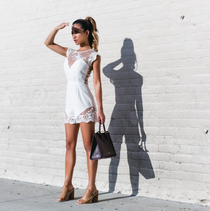 Rompers are an easy way to an effortless and elegant outfit. Jessi Malay's summer romper is enviable; the lace detailing is a beautiful touch, and the white colour makes it a seasonal must-have. Romper: Revolve, Shoes: Sol Sana