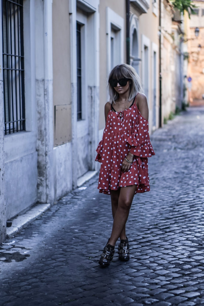 Camille Callen looks quirky and cute in this polka dot summer dress. Pair it with some statement sunnies for a charming look.   Dress: Revolve