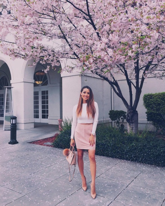 Jessica Ricks wears a gorgeous pink suede pencil skirt with a cropped white tee and nude heels to create this spring-ready style.   Brands not specified.