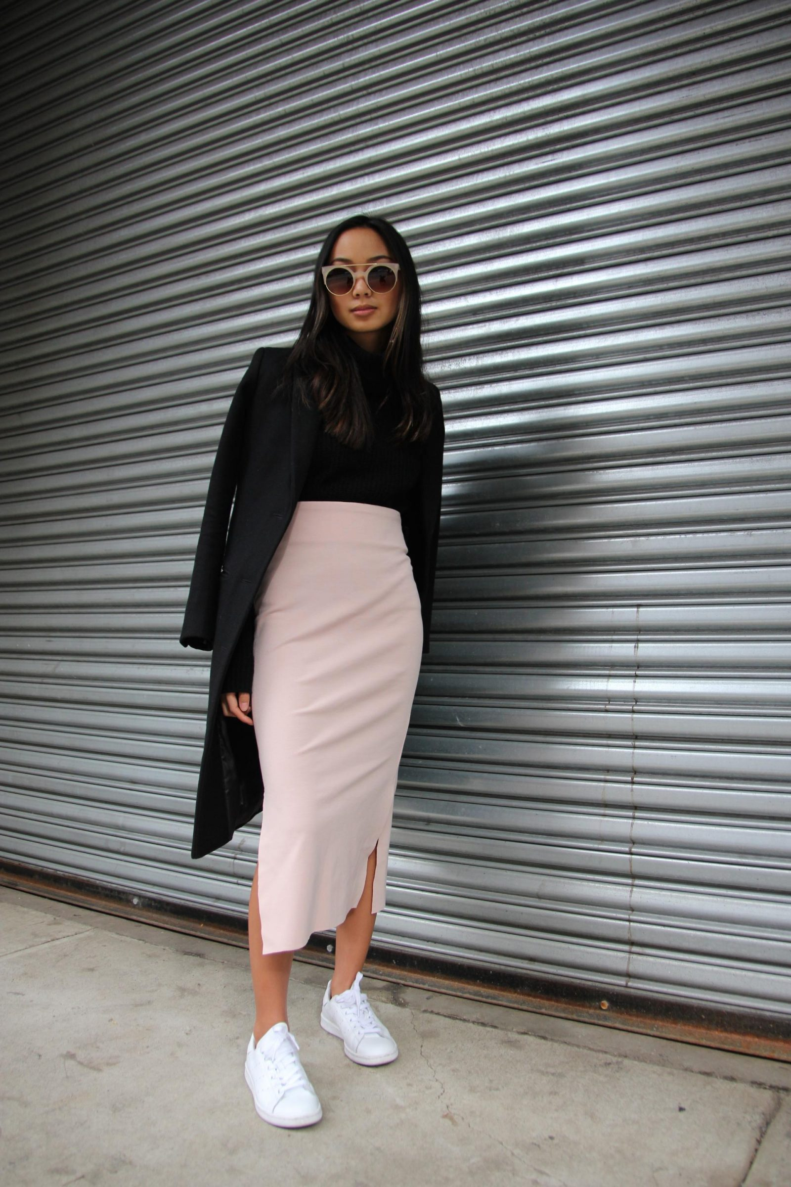 There's something inherently gorgeous about blush and black that we had to share this ensemble by Linh Niller Huynh! The color combo is powerful yet feminine and a pair of Keds-style sneaks, a calf-length pencil skirt and a gorgeous coat can go a long way when you're planning fresh spring outfits! Skirt: Sara Jane Knapp, Top: 360cashmere, Coat: J.Crew, Shoes: Stan Smiths
