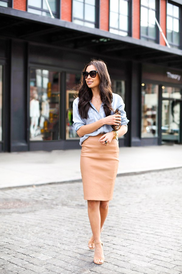 An effortless look from Kat Tanita shows us exactly how to pull off a classic, transitional day-to-night outfit in seconds. Pair a collared button-down and a knee-length pencil skirt with some comfy nude heels and you're off! Skirt: DVF, Top: Rails LA, Shoes: Stuart Weitzman, Purse: Clare Vivier, Sunglasses: Celine, Necklace: Dogeared