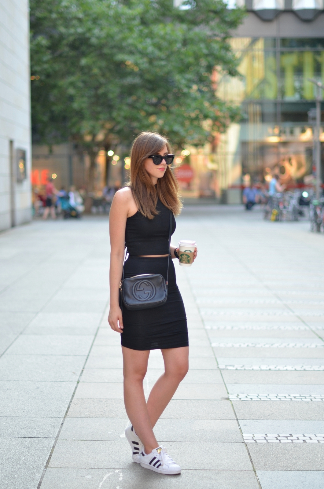 Barbora Ondrackova is ready to run through the streets for her Starbucks in this all-black cropped top and pencil skirt combo. Switch out the sneaks for heels or booties and add a smoky eye and nude lip and you'll be ready to run right through the night, too! Skirt: H&M, Top: Choies, Shoes: Adidas, Purse: Gucci, Sunglasses: Celine, Watch: Kapten&Son
