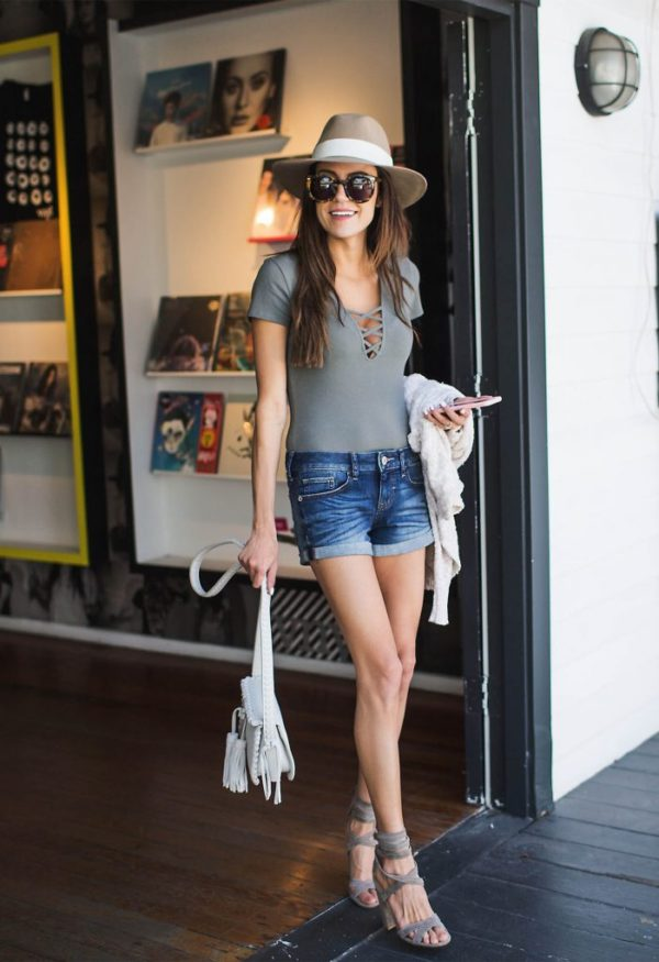 A short-sleeved bodysuit in a stylish neutral like black, white, or grey is an ideal outfit starter – It goes with everything. Just take a look at Christine Andrew looking fab in a stylish tan hat, jean shorts and bodysuit for a quick, anytime outfit. Bodysuit: Express, Shorts: Express, Sweater: Express, Shoes: Nordstrom, Purse: ILY Couture, Hat: Nordstrom