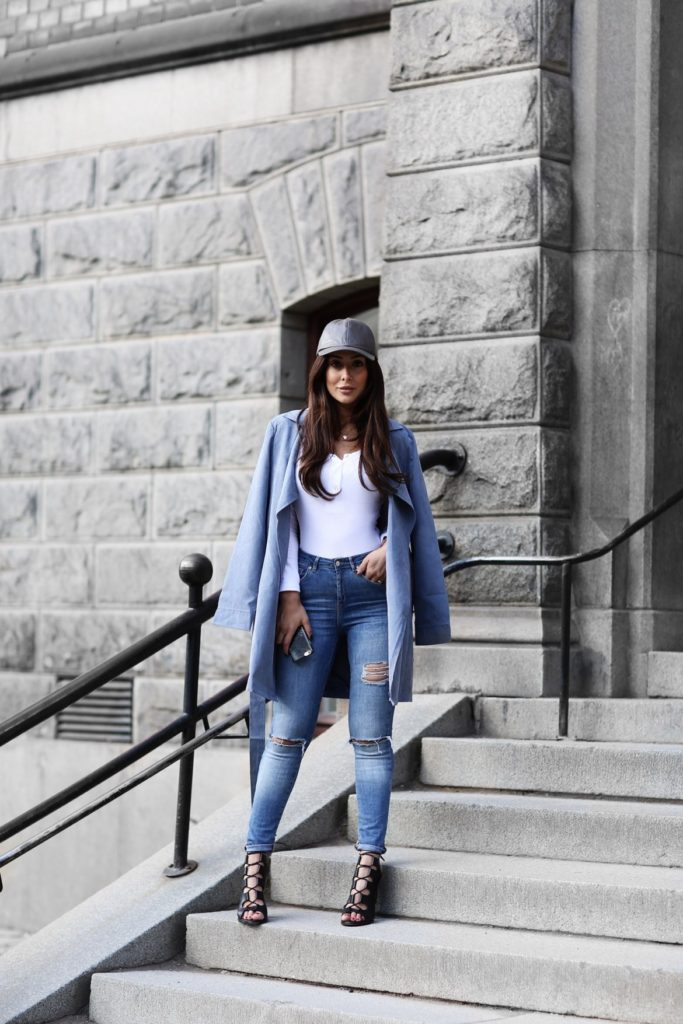 Blue and white and babe all over, Sharareh Sophia shows us how a bodysuit can be worn in any weather. Swap the short sleeves and plunging neckline for a long-sleeved knit bodysuit and jeans for a casual look that can be dressed up or down with any of your coats, hats, and other accessories.  Bodysuit: Nelly, Coat: Nelly, Shoes: Henry Kole, Hat: Want My Look, Watch: Nick Cabana