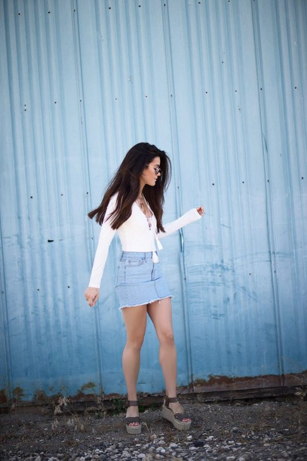 We just love the way a white bodysuit pairs with denim! Sarah Butler can do no wrong with her denim mini and platform sandals when they're paired with this unique tassel tie-front bodysuit from Express. And that circular, Capwell+Co statement necklace? We adore it. Bodysuit: Express, Shorts: Express, Sweater: Express, Shoes: Nordstrom, Purse: ILY Couture, Hat: Nordstrom