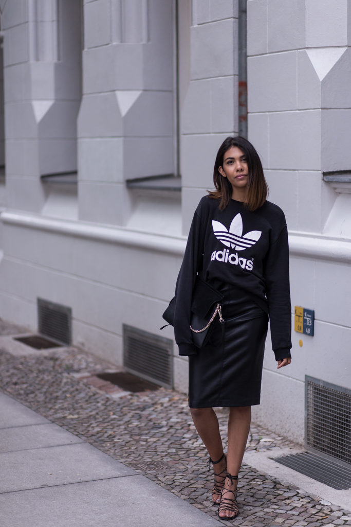 Storm takes the sports luxe trend to a new level by pairing her Adidas sweater with a body con skirt for a polished look. Now this is how to do street chic.  Sweater: Adidas, Skirt: Zara, Sandals: Mango, Bag: Chloe,