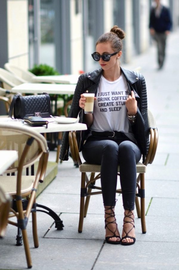 Barbora Ondrackova wears statement strappy shoes and a quirky slogan t-shirt whist enjoying a coffee. Top: Rad, Jeans: Topshop, Leather Jacket: Zara, Heels Stuart Weitzman, Bag: Chanel, Watch Michael Kors: Bracelet: Michael Kors