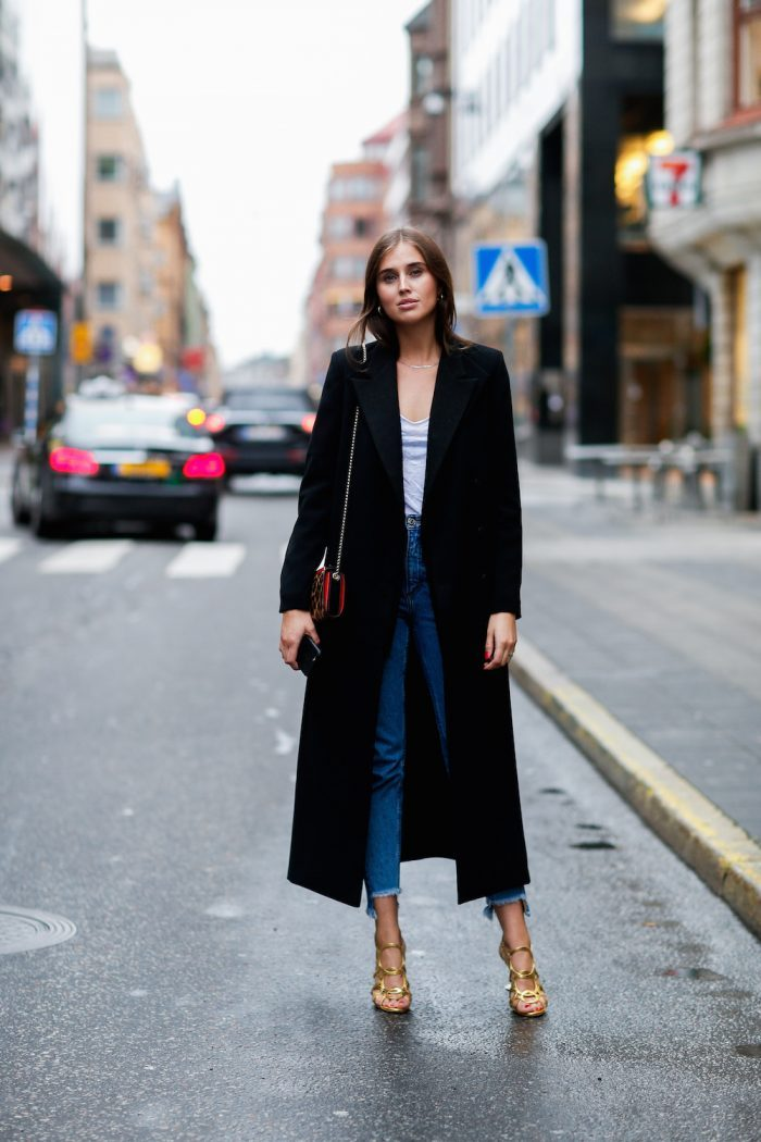 The duster coat is a great way to elongate your frame and look 6ft tall like Darja Barannik. Wear your coat with heels and jeans or shorts. She also adds some sparkle with her gold Louboutin heels. Coat: Stylein, T-shirt: Elle & Il, Jeans: Monki, Shoes and Bag: Christian Louboutin, Necklace: Rebekka Rebekka.