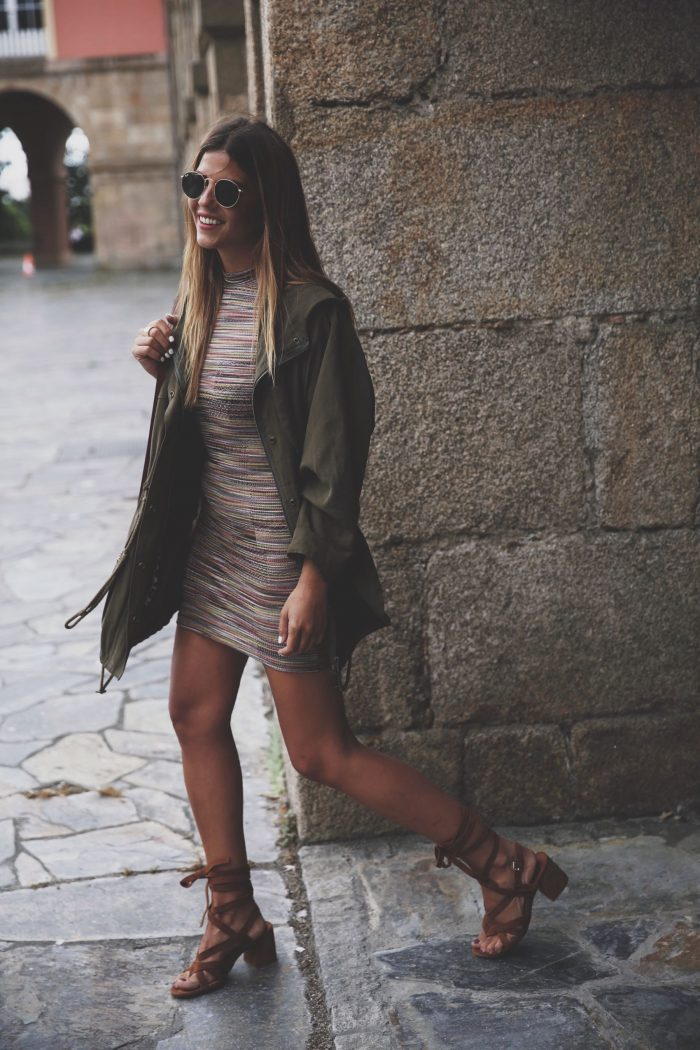 Natalia Cabezas looks like a ray of sunshine in her stripped mini dress and suede sandals. She dresses down her look by throwing on a khaki parka. For fall match your stripped dress with knee high boots or layer with transparent tights. Dress: ASOS, Parka: Zara, Sandals: Mango, Jewelery: A Trendy Life x Fguzkiore, Bag: Chloe