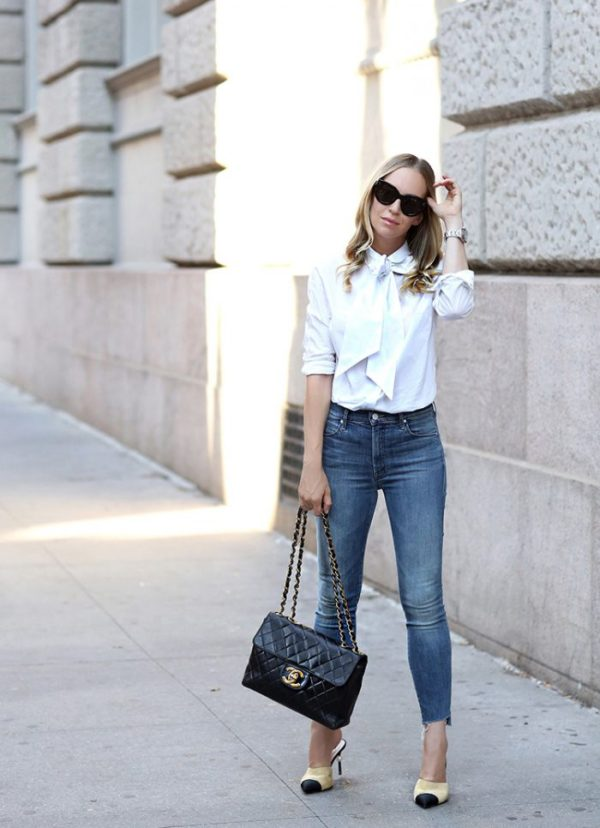 The white shirt is a timeless classic that every woman should own. Helena Glazer looks ladylike tucking her shirt into her denim skinnies for a youthful look. Shirt: Frame, Jeans: Mother, Mules: Chanel, Bag: Vintage Chanel, Sunglasses: Celine