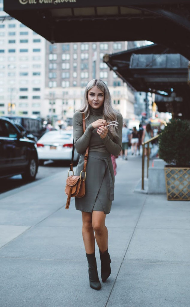 Cara Loren nails the block booty trend by pairing them with a military green turtleneck and wrap skirt. Her leather Chloe bag accents the look perfectly.   Bag: Chloe, Boots: Windsor, Skirt: River Island, turtleneck: Asos