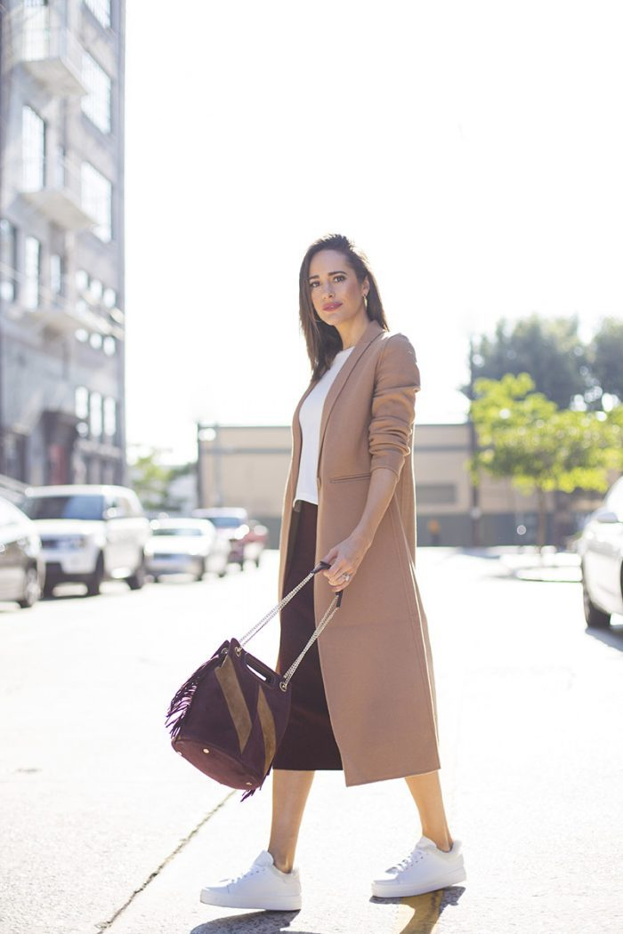 Louise Roe mixes and matches key fall colors. This look is fun and striking yet casual. If you prefer jeans to skirts then a pair of blue denim jeans would also work just as well with this outfit. Coat, Top, Shoes, Bag and Earrings: Maje