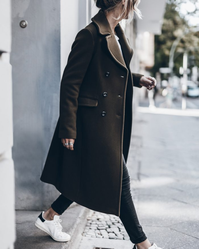 Combine the military trend and sportswear trend by pairing your sneakers with a long line coat like Jacqueline Mikuta. Her look is practical for a busy day yet still stylish and on point. Coat: Marc O' Polo