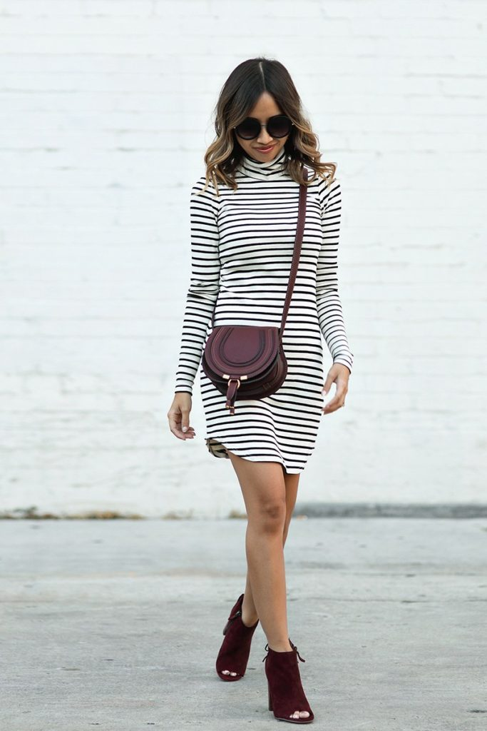 Kim Le looks effortless in a horizontal stripped dress and burgundy accessories. Her peep toes boots are a great fall transition piece and match her Chloe bag perfectly. This look would also look great if you wanted to add layers such as an oversized knit scarf.  Dress: Rebecca Minkoff, Bag: Chloe, Boots: Halogen, Sunglasses: Nordstrom