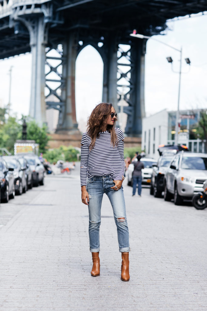 Shalice Noel knows how to wear the nautical trend. She keeps her look on point with block heeled ankle boots, perfect for parading the New York streets. For fall match this look with a brown or beige shearling coat.  Jeans: Rails LA, Boots: Topshop, Strip Top: Philosophy.