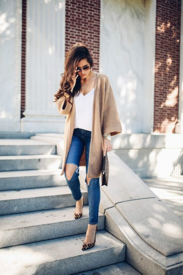 Emily Gemma has created the perfect blend of comfort and class here, in this gorgeous cable knit cardigan paired with distressed jeans and statement heels in leopard print. Cardigan: Asos, Jeans: AG Jeans, Shoes: Christian Louboutin.