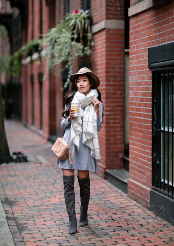 An oversized scarf is a must have this winter! Jean Wang has paired this piece with a long sleeved mini dress and thigh high suede boots, creating a gorgeous festive style which we love. Dress: Boohoo, Boots: Halogen, Bag: Gucci.
