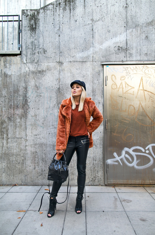 A faux fur coat is a must have this winter! Paired with leather leggings and a cute peaked hat, this coat screams glamour chick! Via Angelica Blick. Sweater: Gina Tricot, Trousers: Angelica Blick, Shoes: Daisy Street.