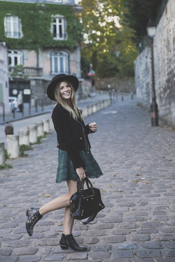 Natalia Cabezas looks cute and playful in this retro fall style consisting of a suede jacket, bottle green mini dress, and a wide brimmed fedora for that vintage touch. Wear this look with leather boots to capture Natalia's everyday look. Dress: Revolve Clothing, Jacket: Zara, Boots: Chloe, Hat: Goorin Bros.