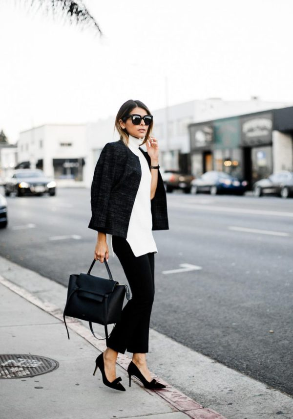 Pam Hetlinger oozes girlish glamour in this stunning combination of a sleeveless turtleneck, black culotte trousers, and a pair of stilettos. Pair this look with shades and a sleek leather bag to capture this ultimate fall style! Outfit: Ann Taylor.