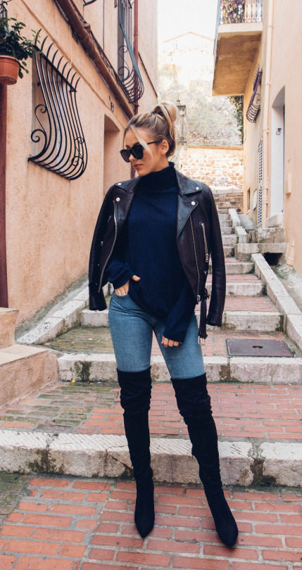 Sendi Skopljak is killing it in these stunning over the knee boots, worn in classic rock chick style with a knit pullover and a biker jacket. We love this original and authentic look! Sweater: Nelly, Jeans: Bershka, Jacket: Acne Studios.