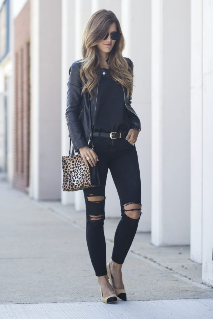 Brenna keeps it cool in an all black outfit consisting of a plain tee, distressed jeans, a leather jacket and a belt to sinch her waist. Break up the black and add a dash of colour with a statement mini bag like this leopard print piece. Jacket: Express, Cami: H&M, Jeans: Elliott.