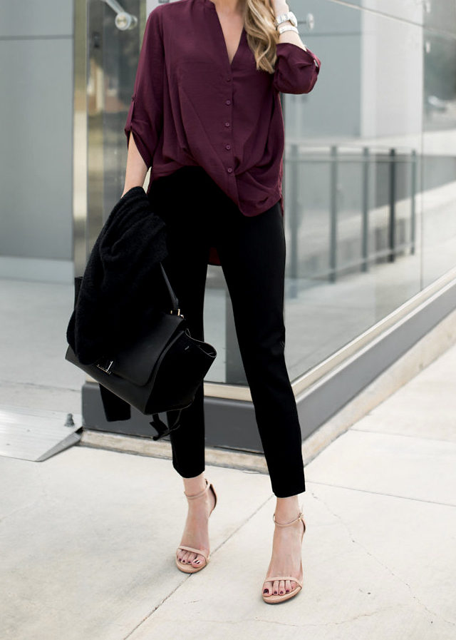 You couldn't get a more simplistically chic look than this; a plum v neck blouse paired with black culottes and white sandals. Krystal Schlegel wears this look with a leather bag and minimal accessories to create this cute everyday style. Blouse/Trousers: Nordstrom.