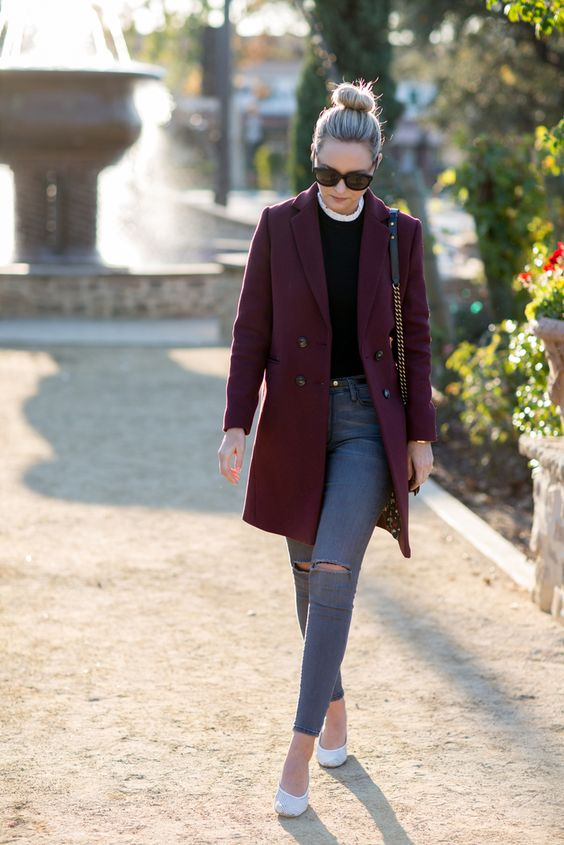 Liz Cherkasova is sleek and sophisticated in this gorgeous burgundy overcoat, paired with mildly distressed denim jeans and a black tee for an overall authentic fall style. Coat/Top: Sézane. Jeans: Citizens of Humanity, Shoes: Amélie Pichard.